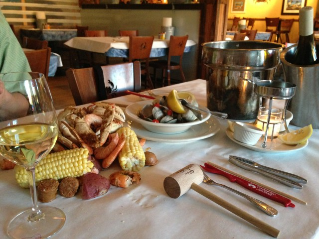 "Cracked Crab dumps the ""Bucket for Two"" directly on your table. They supply wooden mallets so that you can clobber your food."