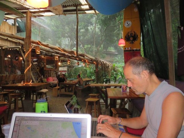 Protected from a downpour at Flutterby Hostel in Uvita
