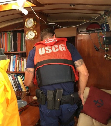 "Two hunky coast guard officers boarded My Destiny just outside Jensen Beach for a random inspection. When one of them asked if we were carrying firearms, James chuckled and said, ""No, we're Canadian""."