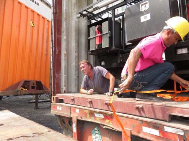 John had to climb out of the driver's window and crawl under the rig to get out of the container