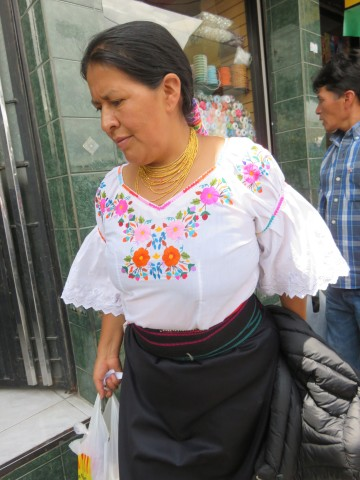 Traditional Otavaleña blouse, gold necklace, sash, and skirt